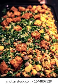 Turmeric rice with lentils, carrots, crispy tofu and kale