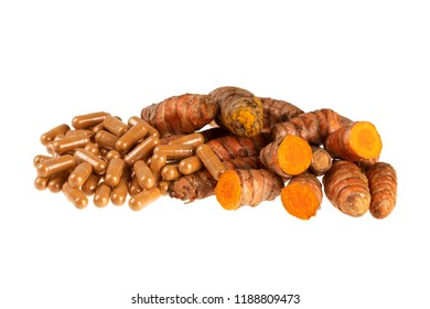Turmeric root and capsules isolated on a white background