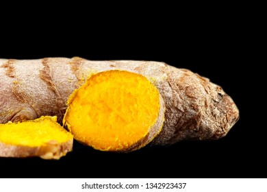 turmeric root close-up isolated on black, concept healthy Ayurveda food