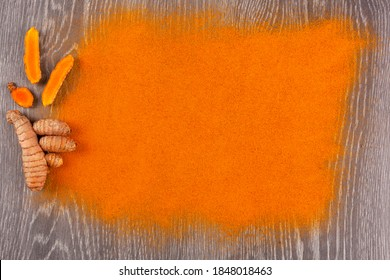 Turmeric root and curcuma spice background. Herbal medicine, nutrional supplement.