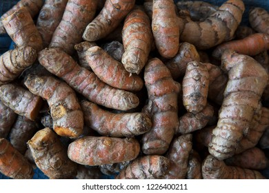 Turmeric root food background