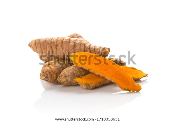 Turmeric root on white background. Natural antioxidant, herbal remedy.