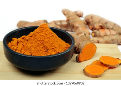 Turmeric root and Turmeric Powder in bowl, Indian spices, an organic and healthy ingredient