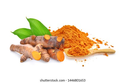 turmeric root and turmeric powder in wooden spoon with leaves isolated on white background
