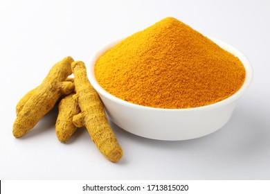 Turmeric roots with turmeric powder