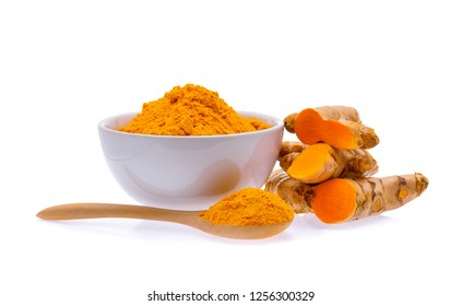 Turmeric roots and turmeric powder isolated on white background