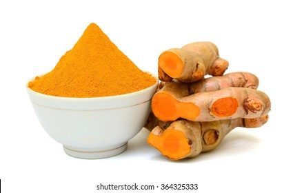 Turmeric roots with turmeric powder isolated on white background