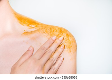 Turmeric in spa on body woman on white background