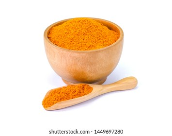 Turmeric or tumeric powder ( known as curcumin, Curcuma longa Linn) in wooden bowl and spoon isolated on white background. Full depth of field with clipping path. Natural herbal plant concept.