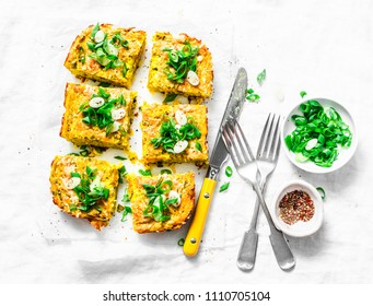 Turmeric, zucchini, mashed chickpeas tortilla with herbs on a light background, top view. Delicious appetizers or snack