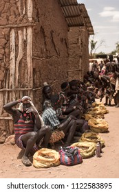 TURMI, ETHIOPIA - AUGUST 17, 2015: unidentified men at the weekly market of Turmi, Ethiopia, which is the largest Hamer Market in the Omo valley.