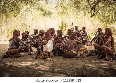 TURMI, ETHIOPIA - August 17, 2015: unidentified Hamer women wait under a tree at the bull jumping ceremony. Bull jumping is an initiation ceremony for Hamer boys