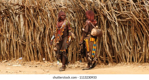 TURMI, OMO VALLEY, ETHIOPIA - 29 JULY 2013: Ethiopian people from Hamer people being a local ethnic market trader in Turmi