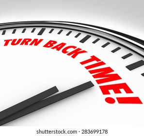 Turn Back Time words on a clock face to illustrate the reversing of aging, flashback or looking to the past or history