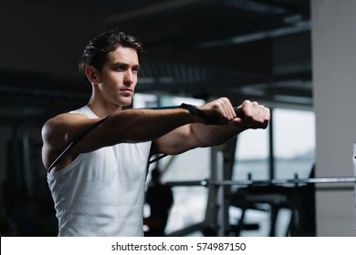 Turn up the intensity. Young man working out with a resistance band in gym