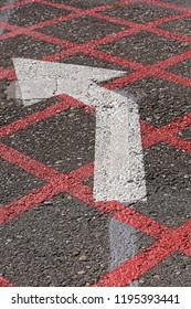 Turn left direction arrow at tarmac