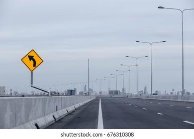 Turn left sign on highway