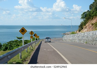 Turn of mountain road with blue sky and sea on a background