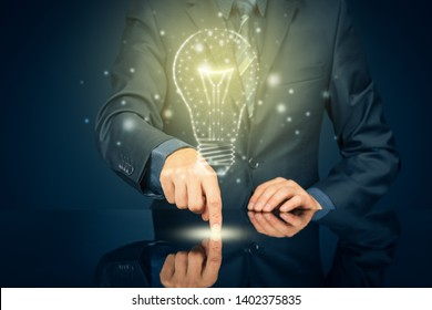 Turn on creativity, idea and intelligence concepts. Businessman and graphics light bulb - symbols of idea, creative thinking, innovations and intelligence.