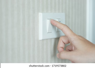 turn on light switch on the wall