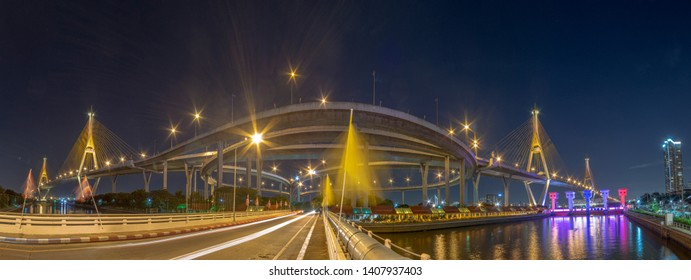 """Turn on the lights in many colors at night. Thai translation: the name of the bridge over the pillar """"Bhumibol Bridge 1"""" and """"Bhumibol Bridge 2"""""""