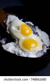 turn overer chicken eggs, large yolks, wooden spatula, sour cream