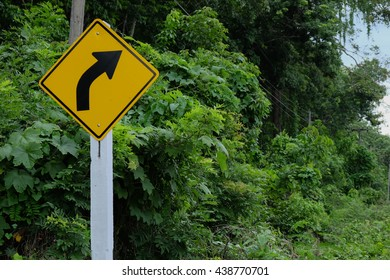 Turn right sign on the road