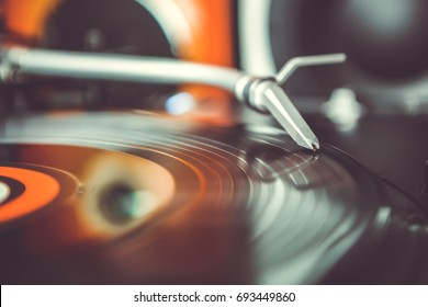 Turn table records player in closeup.Party dj turntable play vinyl disc with music.Scratch hip hop songs & remix tracks at party.Professional stage audio equipment for entertainment event
