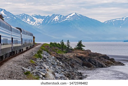 Turnagain Arm of Cook Inlet in Alaska from the Train showing the shoreline with mountains and glaciers in the background