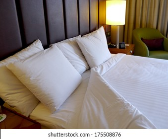 turned down bed in hotel room