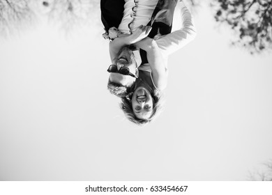 Turned upside down picture of happy bride and groom
