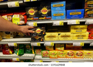 TURNHOUT, BELGIUM - AUGUST 15, 2018: Aisle with tea packings in a Delhaize hypermarket containing Lipton and Twinings brand products.