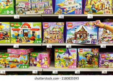 TURNHOUT, BELGIUM - AUGUST 17, 2018: Lego Friends and Lego Duplo boxes on shelves in a Carrefour Hypermarket. LEGO is a popular line of construction toys manufactured by The Lego