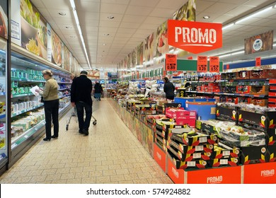 TURNHOUT, BELGIUM - OCTOBER 20, 2016: Interior of a Lidl supermarket. Shopper choose in the refrigerated fresh products aisle. Lidl is a German discount chain with stores in 28 countries in Europe.