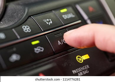 Turning on the air conditioning of a car