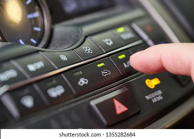 Turning on the air conditioning of a car on the climate control panel