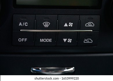 Turning on the air conditioning of a car on the climate control panel. - Shutterstock ID 1653999220