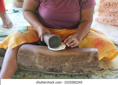 Turning a small, rough strip of bark into a piece of fine cloth is a painstaking process. With an tapa beater, a woman beats the bast until becomes a wide piece of fine cloth.