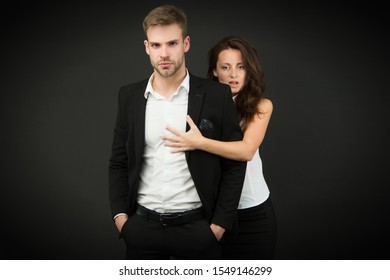Turning your passion into business. Couple of business partners. Working couple on dark background. Couple in love in formal wear. Romantic couple of handsome man and sensual woman.