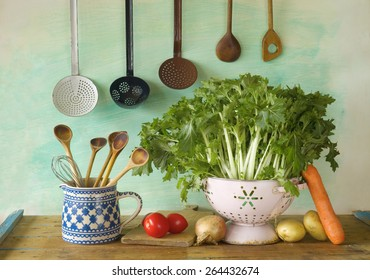 turnip green and various vegetables plus kitchen equipment