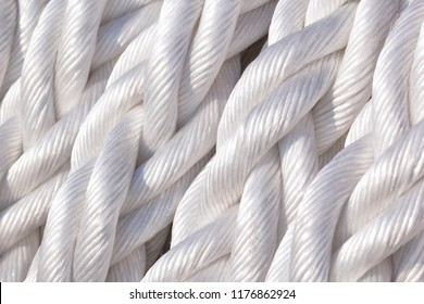 The turns of the white twisted nylon ship rope close up
