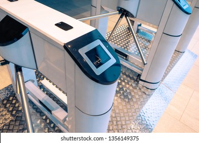 Turnstile at the entrance. Electronic turnstile. Turnstile spinner. Control at the entrance. Identifying people at the entrance. Security in the enterprise.