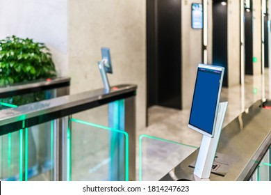 turnstile gate in office building with digital facial scaner.