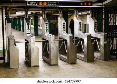 Turnstiles (baffle gates) in a New-York subway station.