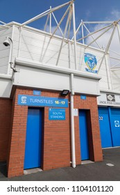 Turnstiles and the logo of rugby league team Warrington Wolves at The Halliwell Jones Stadium in Warrington