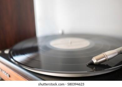 turntable, black vinyl playing tracks on record player
