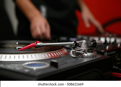 Turntable dj vinyl record player,analog sound technology for DJ playing analog and digital music.Close up, macro of disc jockey equipment for professional studio,concert, event
