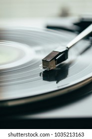 Turntable with gramophone record playing music.  Close up turntable needle on vinyl record. Record, LP, gramophone