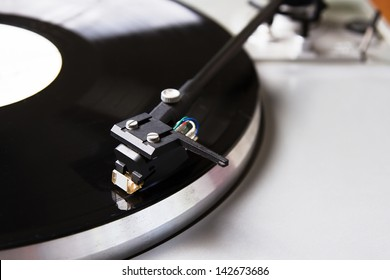 Turntable player with musical vinyl record. Useful for DJ, nightclub and retro theme.