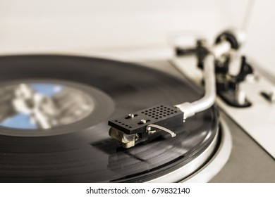 Turntable playing record side view selective focus